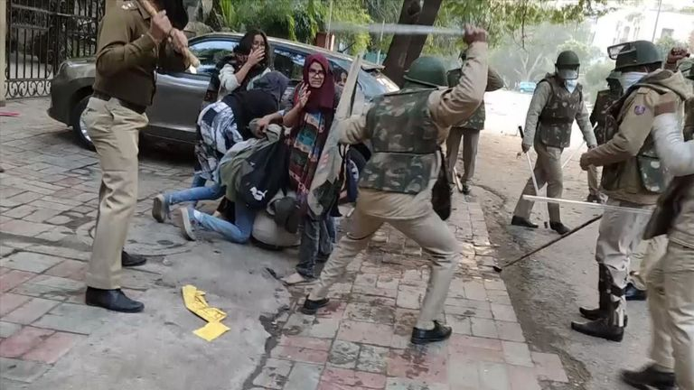 Image result for woman beaten for NRC protest